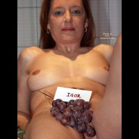 Grapes Covering Pussy - Looking At The Camera