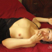 Topless Brunette Reclining - Brown Eyes, Brunette Hair, Erect Nipples, Hard Nipple, Small Tits, Topless, Looking At The Camera