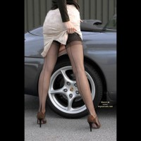Girl Standing In Front Of A Porsche - Long Legs, Rear View, Stockings