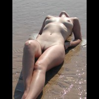Lying Naked On Beach In The Water - Landing Strip