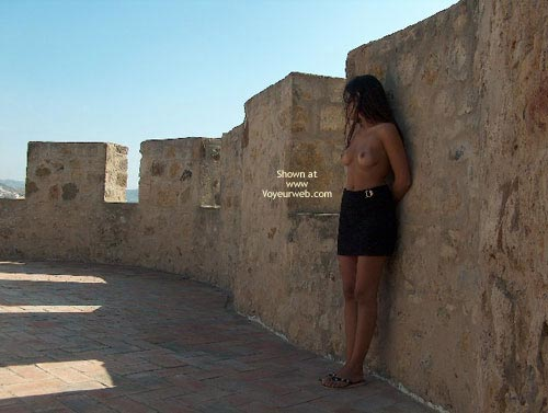 Pic #1 - Against A Wall - Nude Outdoors, Topless In Public , Against A Wall, Outdoors, Naked Breasts In Public, Topless In Public, Posing By Wall, Flip Flop Sandals, Black Skirt