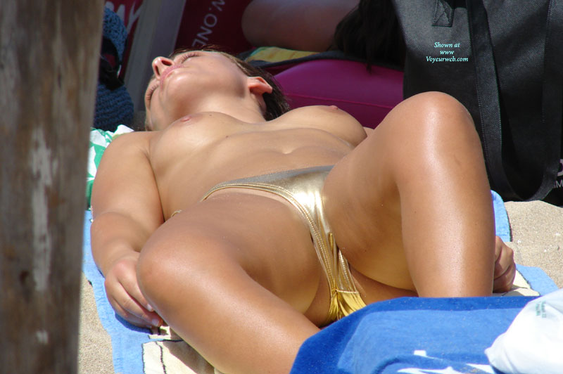 Pic #1 - Voyeur Topless Girl On Beach - Brunette Hair, Topless Beach, Topless, Beach Tits, Beach Voyeur , Big Jugs, Topless Face Up On Towel, Topless Sunbathing, Tanned Breasts, Shiny Bikini, Smooth Legs, Topless Girl