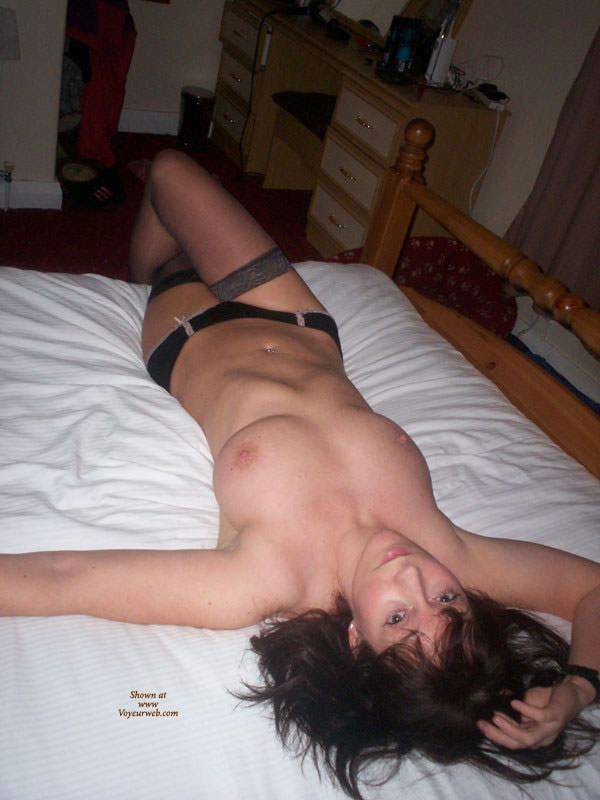 Pic #1 - Topless Girlfriend Black On Bed - Dark Hair, Large Breasts, Stockings, Topless, Looking At The Camera, Naked Girl, Sexy Girlfriend, Sexy Legs , Big Natural Breasts, Slim Waist, Wavy Dark Hair, Pierced Belly Button, Legs Crossed, Knee Bent, Topless On Bed, Laying Across Bed