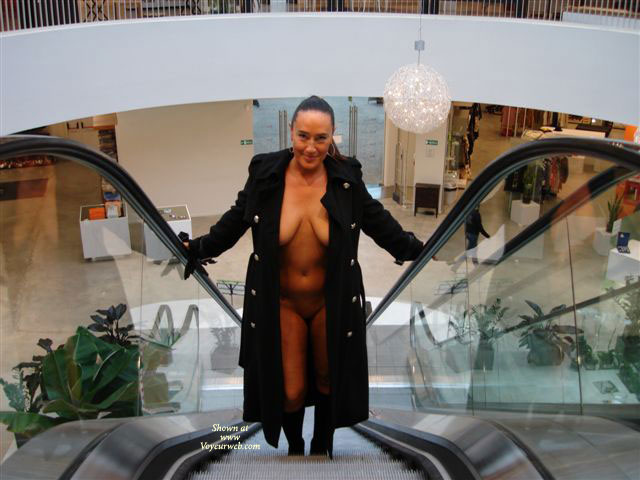 Pic #1 - Public Nude - Brunette Hair, Cleavage, Exposed In Public , Public Nude, Nude On Escalator, Flash In Public, Cleavage, Exposed In Public, Brunette, Black Trench Coat, Mall
