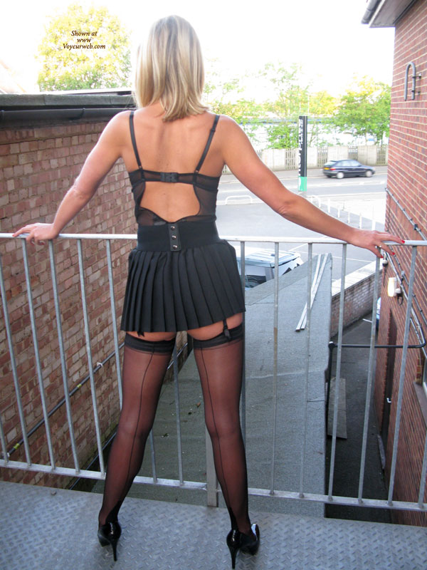 Pic #1 - Amateur Dressed Sexy - Heels, Milf, Stockings , Alley Cat, Black Short Skirt, Stockings, Standing By The Fence, Black Thigh Highs, Milf Cougar, Thigh Highs, Posed For Upskirt.., Micro Skirt
