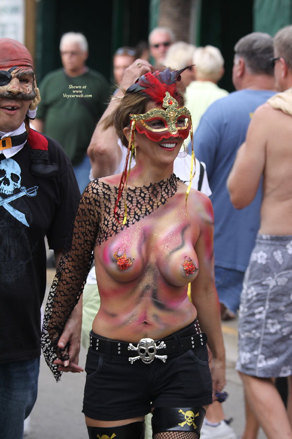 Pic #1 - Topless In Public Wearing Body Paint - Brunette Hair, Large Breasts, Topless , Pirates Mate, Pained Tits, Pen Mouth, White Teeth, Festival Voyeur, Nice Smile, Topless With Body Paint, Short Brunette Hair