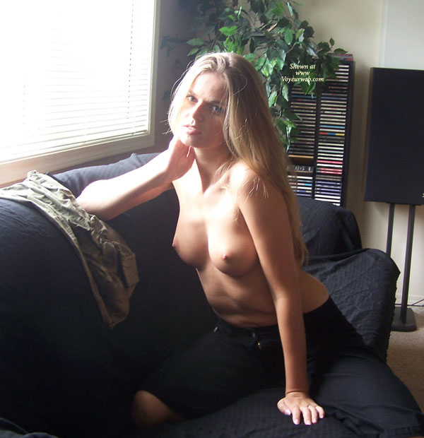 Pic #1 - Posing At The Window - Perky Tits, Topless Blonde, Looking At The Camera , Posing At The Window, Perky Tits, Topless Blonde, Looking Into Camera