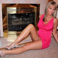 Milf Seated Pantieless In Front Of Fireplace - Blonde Hair, Heels, Long Hair, Long Legs, Milf, Sexy Legs