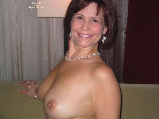Pic #1 - Topless Indoors - Perky Nipples, Topless , Topless Indoors, Sitting Up, Big Smile, C Cup, Perky Nipples, Small Areolas