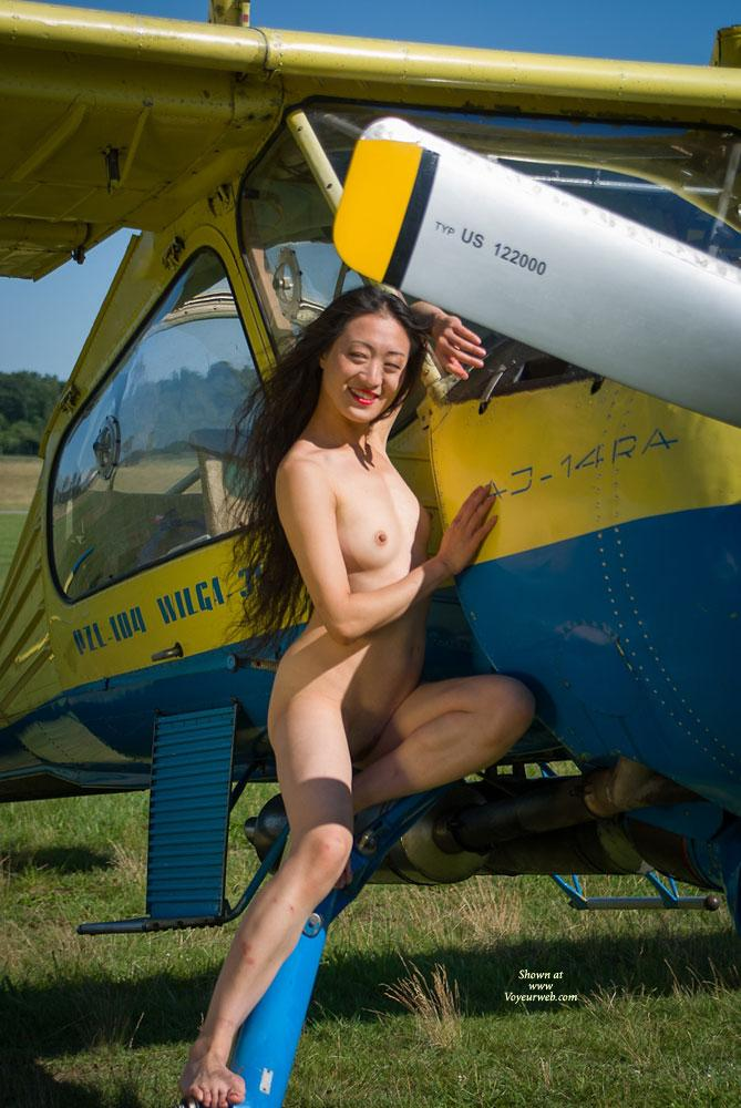 Pic #1 - Airplane - II - Asian Girl, Flashing, Small Tits, Dressed , Some Guys Asked If Lin (a Girl Friend Of Stephanie, See Pic. One) Would Agree To Pose. She Did...