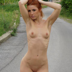 Sweet Exhibitionist Vienna Walking Along A Road Holding Her Hair Up - Exhibitionist, Flashing, Red Hair, Shaved Pussy, Small Tits, Naked Girl, Nude Amateur