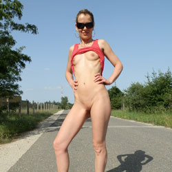 Stripteasing On The Road - Brunette Hair, Erect Nipples, Exposed In Public, Firm Tits, Heels, Nipples, No Panties, Nude In Public, Nude Outdoors, Shaved Pussy, Showing Tits, Small Tits, Strip, Sunglasses, Hairless Pussy, Hot Girl, Sexy Body, Sexy Face, Sexy Girl, Sexy Legs, Sexy Woman