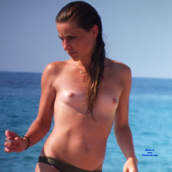 Wet And Topless Brunette At The Beach - Brunette Hair, Nipples, Nude Beach, Nude Outdoors, Showing Tits, Small Tits, Topless, Wet, Beach Tits, Beach Voyeur, Sexy Body, Sexy Girl