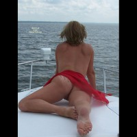 Outdoor Blonde Laying On Stomach Across Boat Deck With Red Sash - Blonde Hair, Tan Lines, Sexy Feet