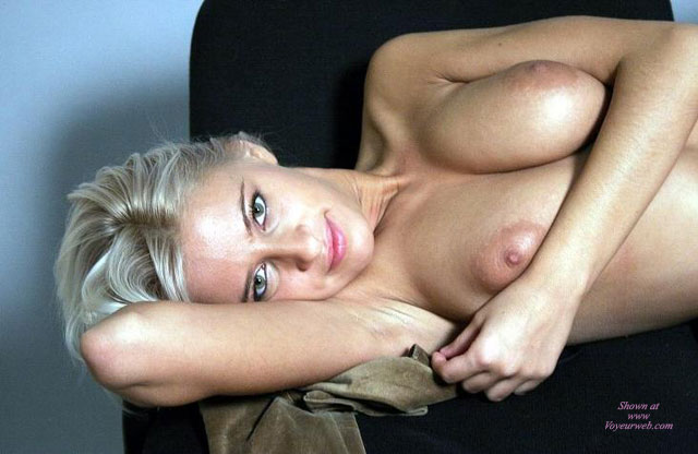 Pic #1 - Close Up Topless Blonde Lounging Arm Under Head Arm Across Breast - Blonde Hair, Topless , Nice Eyes, Topless Portrait With Eye Contact, The Eyes Have It, Prone Position, Kissable Lips, Lying Topless On Chair, Beautiful Blond, Playtime, Blond Boobs, Beautiful Eyes