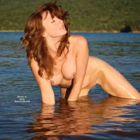 Naked Redhead In Afternoon Sun Kneeling In Water - Erect Nipples, Long Hair, Pierced Nipples, Red Hair, Shaved Pussy