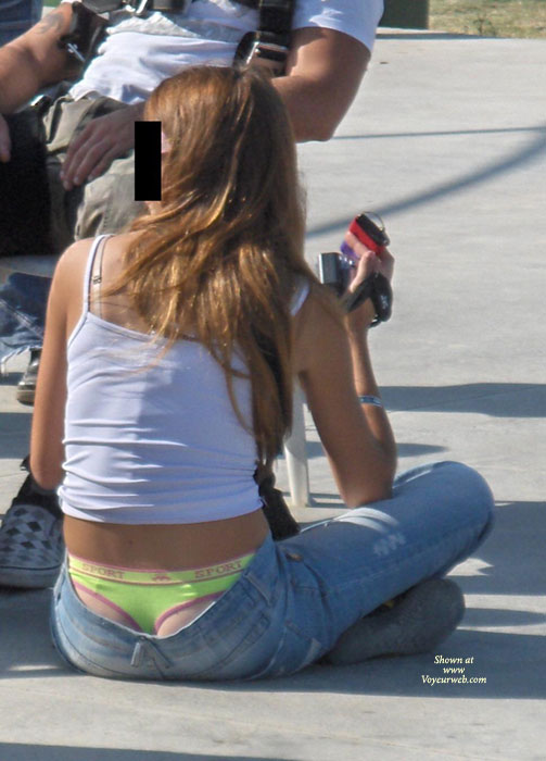 Pic #1 - Street Voyeur - Brunette Hair, Long Hair , Girl Sitting On Side Walk In Thong, White Top, Yellow Thong, Low Hip Jean, Green Pull Me Thong, Blurred Face, Panty Peek, See My Thong, Brunette In Green Thong, Skinny Peekaboo Panty, Thong Exposed In Public, Ass Cleavage, Light Blue Jeans, Crop Top