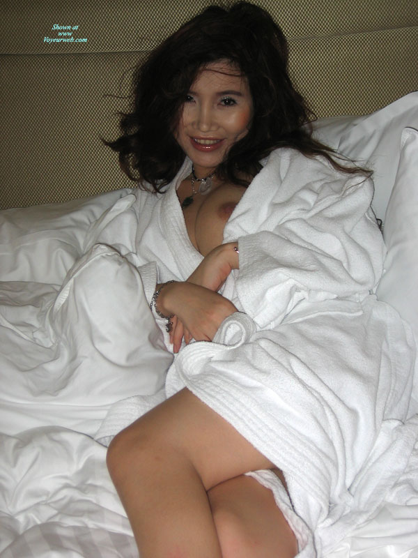 Pic #1 - Asian Girlfriend In Bed - Black Hair, Looking At The Camera , Nipple Poking Out Of White Robe, Lots Of Black Hair, One Breast Showing, Sexy Asian, Oriental Goddess, Smiling And Looking At The Camera, Nipple Slip, White Terry Robe, Girl In A Nice White Robe Showing A Little Tit, Asian Eyes, Silver Necklace