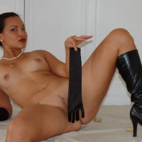 Exotic Looking Girl Reclining Naked With Long Gloves And Knee High Boots - Erect Nipples, Landing Strip, Shaved Pussy, Small Breasts, Spread Legs, Naked Girl, Nude Amateur