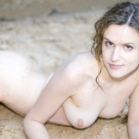 Pale Skinned Girl Laying Outdoors - Blonde Hair, Blue Eyes, Long Hair