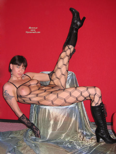 Pic #1 - Fishnet Bodystocking - Black Hair, Brunette Hair, Sexy Face , Knee High Black Lace Up Boots, Black Boots, See-thru Bodysuit, Earrings, Dressed In Net, Naked In Nets, Brunette Short Hair, Black Lace Gloves, Sexy Demanding Face, Black Boots, Black Body Stocking