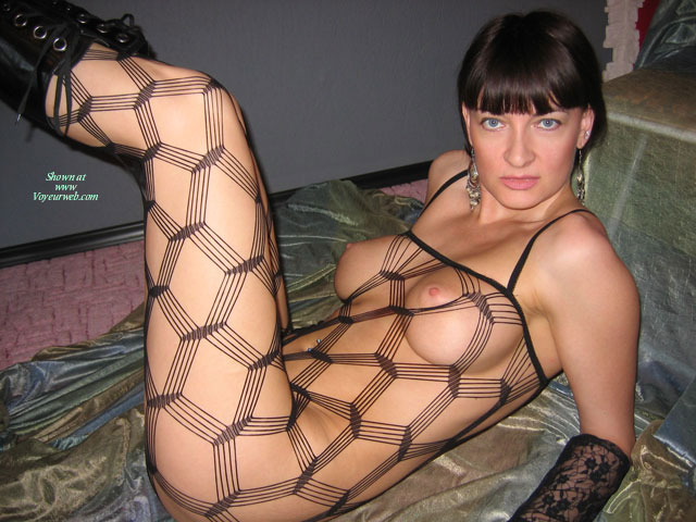 Pic #1 - Crochet Black Body Stocking - Black Hair, Blue Eyes, Erect Nipples, Large Breasts , Perky Nipples, Blue Eyes With Boots, Short, Lying On A Bed, Fishnet Stockings, Dressed In Net, C Cup, Large Firm Breasts, Medium Pink Disk Areolas